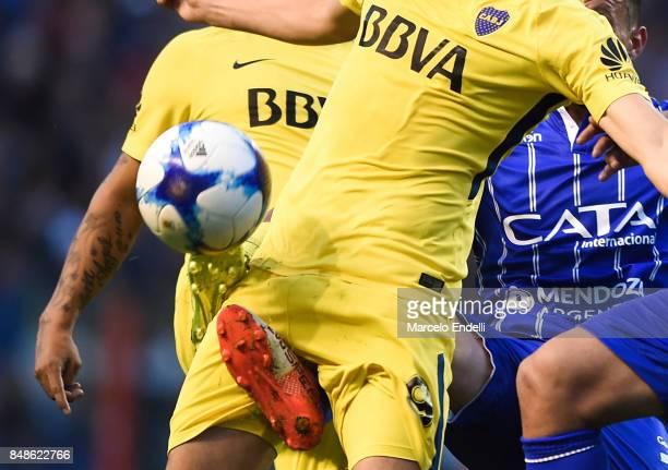 Leonardo Jara of Boca Juniors fights for the ball with Leonel Galeano and Juan Andrada of Godoy Cruz during a match between Boca Juniors and Godoy...