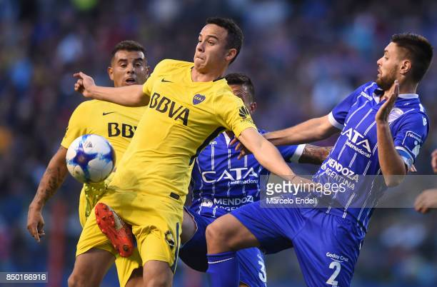 Leonardo Jara of Boca Juniors fights for the ball with Leonel Galeano and Juan Andrada of Godoy Cruz during a match between Boca Juniors and Godoy...