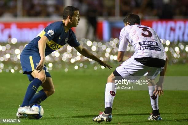 Leonardo Jara of Boca Juniors fights for the ball with Lucas Marquez of Patronato during a match between Patronato and Boca Juniors as part of...