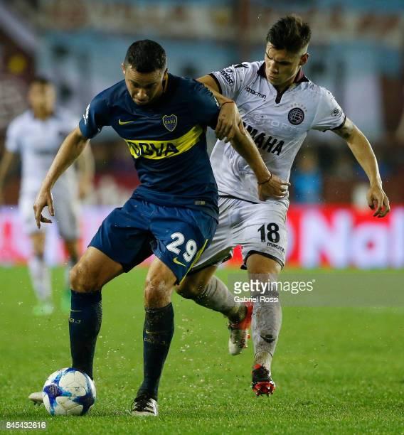 Leonardo Jara of Boca Juniors fights for the ball with Matias Sanchez of Lanus during a match between Lanus and Boca Juniors as part of the Superliga...