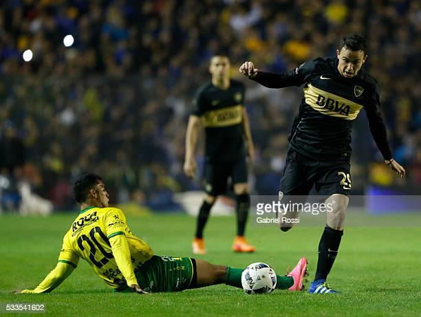 Leonardo Jara of Boca Juniors fights for the ball with Rafael Marcelo Delgado of Defensa y Justicia during a match between Boca Juniors and Defensa y...