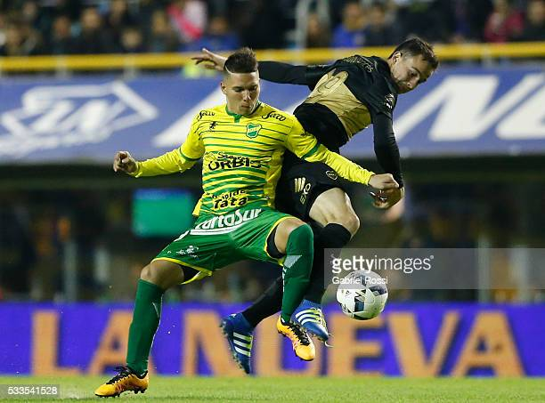 Leonardo Jara of Boca Juniors fights for the ball with Tomas Martinez of Defensa y Justicia during a match between Boca Juniors and Defensa y...