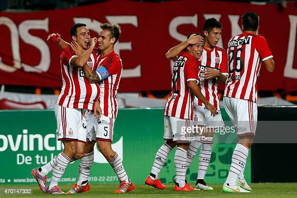 Leonardo Jara of Estudiantes celebrates with teammate Gaston Gil Romero after scoring the first goal of his team during a match between Estudiantes...