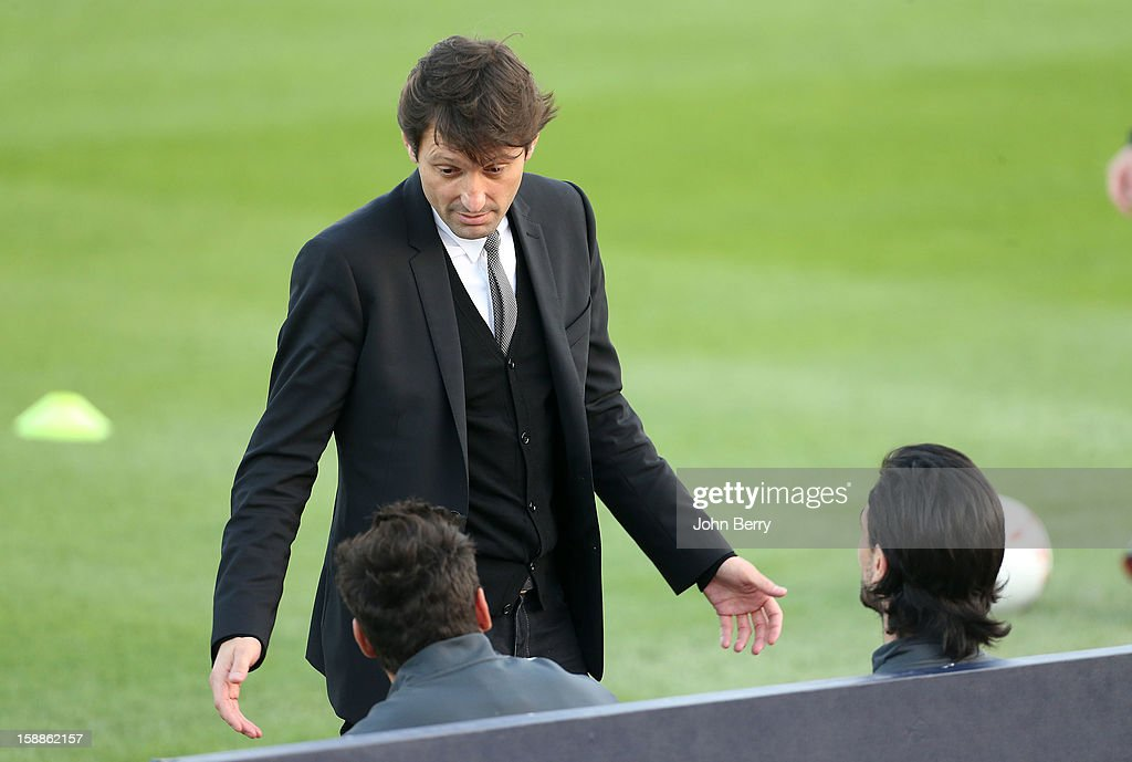 Leonardo, manager of PSG, lectures <a gi-track='captionPersonalityLinkClicked' href=/galleries/search?phrase=Ezequiel+Lavezzi&family=editorial&specificpeople=5451126 ng-click='$event.stopPropagation()'>Ezequiel Lavezzi</a> and <a gi-track='captionPersonalityLinkClicked' href=/galleries/search?phrase=Javier+Pastore&family=editorial&specificpeople=5857872 ng-click='$event.stopPropagation()'>Javier Pastore</a> for arriving one day late at the training camp, before the Paris Saint Germain training session held at the Aspire Academy for Sports Excellence on January 1, 2013 in Doha, Qatar.