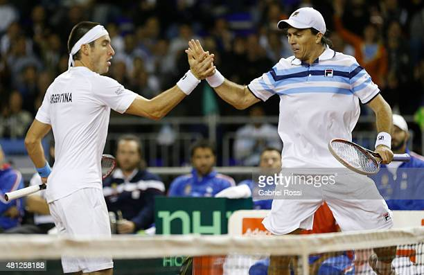 Leonardo Mayer and Carlos Berlocq of Argentina celebrate a point during a quarter final doubles match between Carlos Berlocq / Leonardo Mayer and...