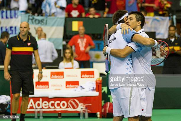 Leonardo Mayer and Carlos Berlocq of Argentina celebrate after winning the doubles match between Ruben Bemelmans/ Steve Darcis and Leonardo Mayer/...