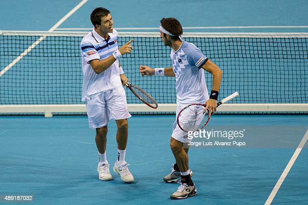Leonardo Mayer and Carlos Berlocq of Argentina celebrate during the doubles match between Ruben Bemelmans/ Steve Darcis and Leonardo Mayer/ Carlos...
