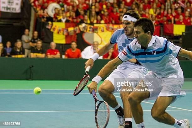 Leonardo Mayer and Carlos Berlocq of Argentina go for a ball during the doubles match between Ruben Bemelmans/ Steve Darcis and Leonardo Mayer/...