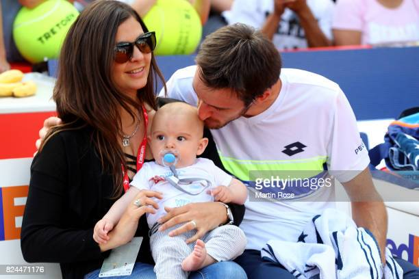 Leonardo Mayer of Argentina celebrate victory over Florian Meyer of Germany with his wife Milagros and son Valentino after the International German...