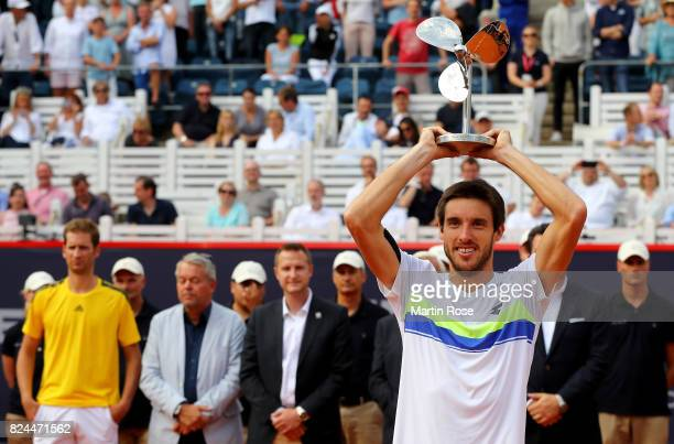 Leonardo Mayer of Argentina celebrate victory over Florian Meyer of Germany after the International German Open at Rothenbaum on July 30 2017 in...