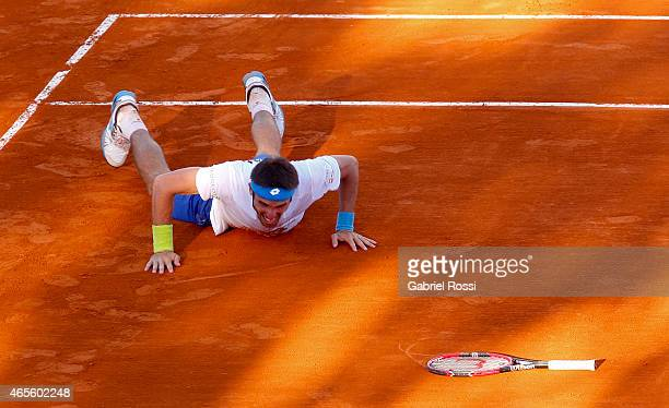 Leonardo Mayer of Argentina celebrates after winning a singles match between Leonardo Mayer of Argentina and Joao Souza of Brazil as part of Davis...
