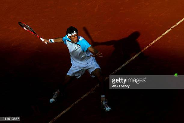Leonardo Mayer of Argentina hits a forehand during the men's singles round three match between Leonardo Mayer of Argentina and Robin Soderling of...