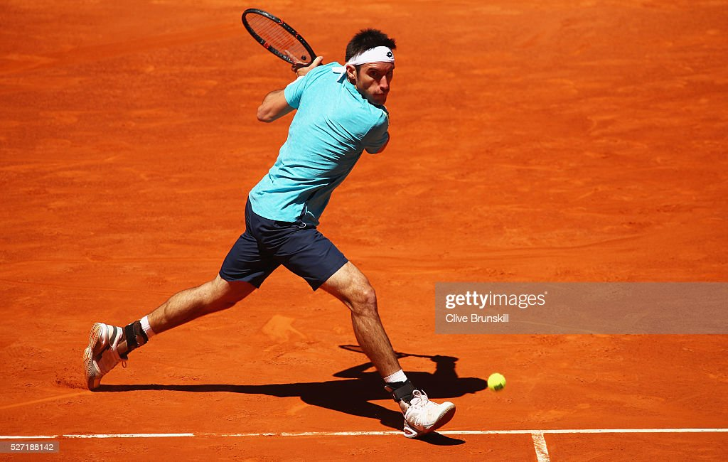<a gi-track='captionPersonalityLinkClicked' href=/galleries/search?phrase=Leonardo+Mayer&family=editorial&specificpeople=2331993 ng-click='$event.stopPropagation()'>Leonardo Mayer</a> of Argentina plays a backhand against Feliciano Lopez of Spain in their first round match during day three of the Mutua Madrid Open tennis tournament at the Caja Magica on May 02, 2016 in Madrid,Spain.
