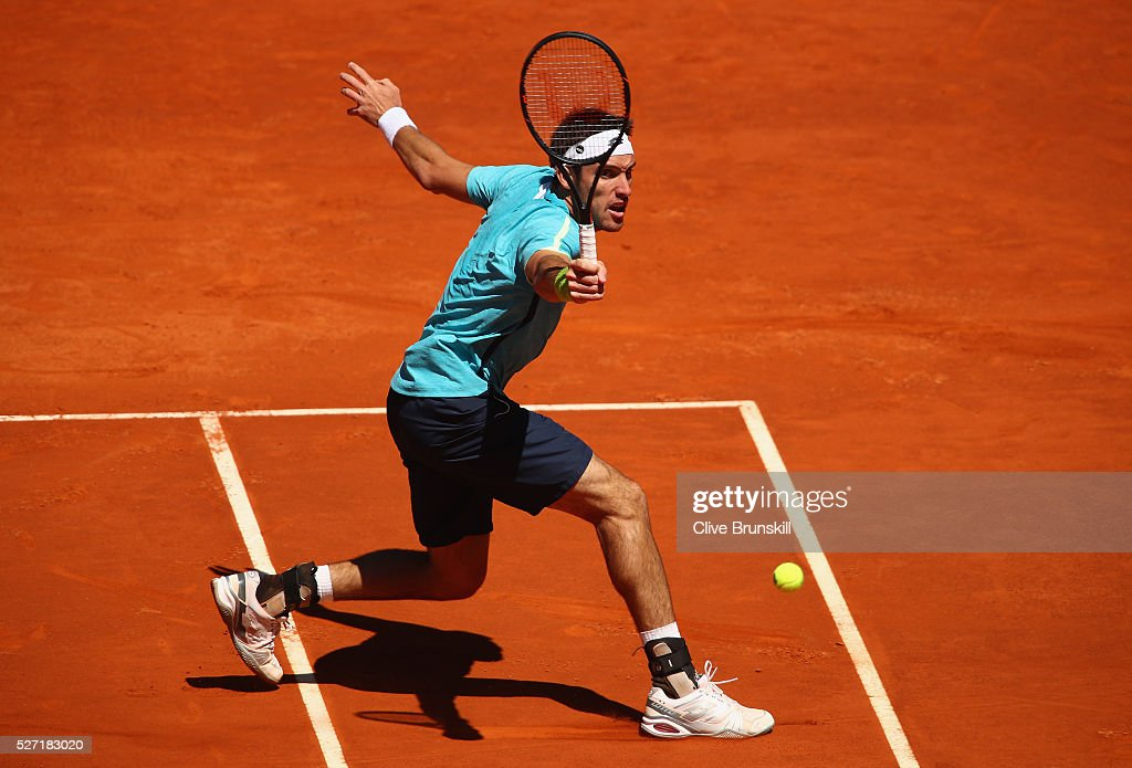 Leonardo Mayer of Argentina plays a backhand volley against Feliciano Lopez of Spain in their first round match during day three of the Mutua Madrid Open tennis tournament at the Caja Magica on May 02, 2016 in Madrid,Spain.