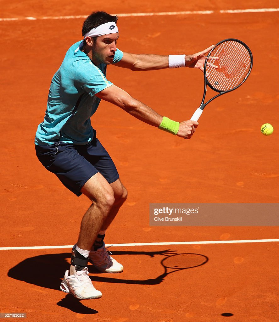 <a gi-track='captionPersonalityLinkClicked' href=/galleries/search?phrase=Leonardo+Mayer&family=editorial&specificpeople=2331993 ng-click='$event.stopPropagation()'>Leonardo Mayer</a> of Argentina plays a backhand volley against Feliciano Lopez of Spain in their first round match during day three of the Mutua Madrid Open tennis tournament at the Caja Magica on May 02, 2016 in Madrid,Spain.