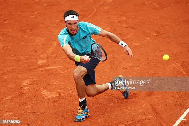 Leonardo Mayer of Argentina plays a forehand during the Men's Singles first round match against Jeremy Chardy of France on day two of the 2016 French...
