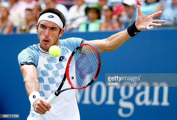 Leonardo Mayer of Argentina returns a shot against Roger Federer of Switzerland during their Men's Singles First Round match on Day Two of the 2015...