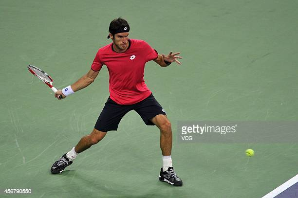 Leonardo Mayer of Argentina returns a shot in his match against Wu Di of China during day three of the Shanghai Rolex Masters at the Qi Zhong Tennis...