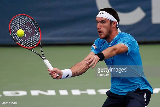 Leonardo Mayer of Argentina returns a shot to Kei Nishikori of Japan during their men's singles match at Rock Creek Tennis Center on August 6 2015 in...