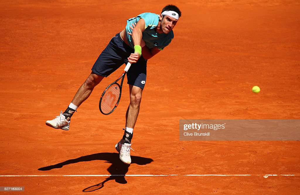 <a gi-track='captionPersonalityLinkClicked' href=/galleries/search?phrase=Leonardo+Mayer&family=editorial&specificpeople=2331993 ng-click='$event.stopPropagation()'>Leonardo Mayer</a> of Argentina serves against Feliciano Lopez of Spain in their first round match during day three of the Mutua Madrid Open tennis tournament at the Caja Magica on May 02, 2016 in Madrid,Spain.