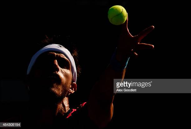 Leonardo Mayer of Argentina serves against Matthew Ebden of Australia during their men's singles second round match on Day Four of the 2014 US Open...