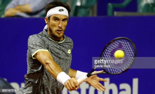 Leonardo Mayer of Argentina takes a backhand shot during a first round match between Leonardo Mayer of Argentina and Gastao Elias of Portugal as part...