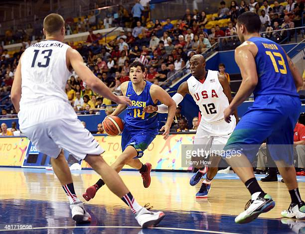 Leonardo Meindl of Brazil dribbles to the basket on Damien Wilkins and Kaleb Tarczewski of the United States of America in a 9383 Brazil win in the...