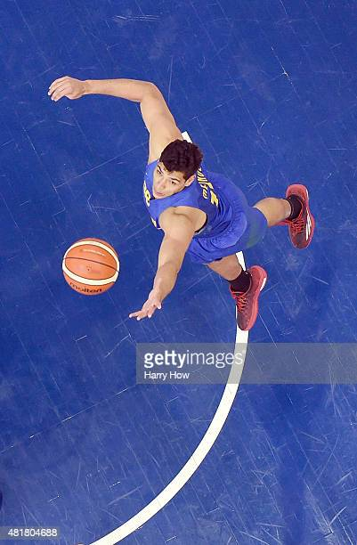 Leonardo Meindl of Brazil jumps for a rebound in a 9383 win over the United States of America in the men's basketball preliminary round during the...