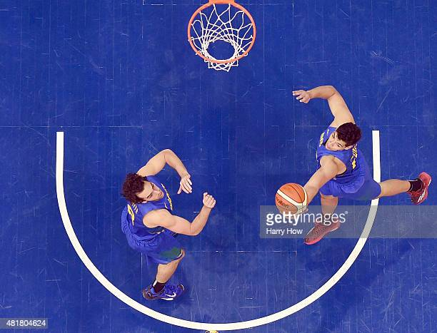 Leonardo Meindl of Brazil jumps for a rebound in front of Vitor Benite in a 9383 win over the United States of America in the men's basketball...