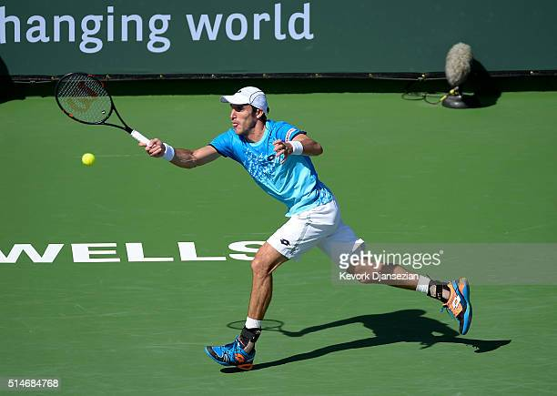 Leonardo Meyer of Argentina hits a forehand against Sam Groth of Australia during day four of the BNP Paribas Open at Indian Wells Tennis Garden on...