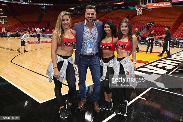 Leonardo Montero an Argentine TV host poses for a photo with the Miami Heat dance team before the game against the Oklahoma City Thunder on December...