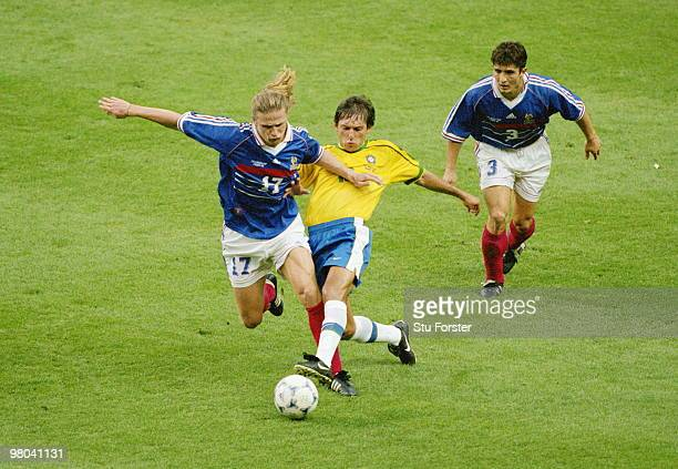 Leonardo of Brazil challenges Emmanuel Petit of France as Bixente Lizarazu looks on during the1998 FIFA World Cup Final match on 12 July 1998 played...