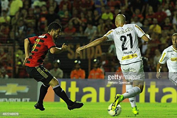 Leonardo of Sport Recife competes for the ball during the Brasileirao Series A 2014 match between Sport Recife and Botafogo at Ilha do Retiro Stadium...