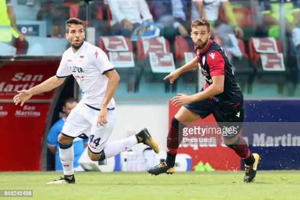 Leonardo Pavoletti of Cagliari and Cazim Sulijc of Crotone compete forn the ball during the Serie A match between Cagliari Calcio and FC Crotone at...