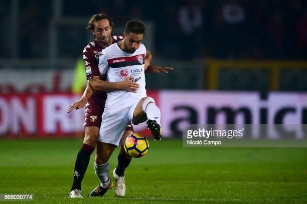 Leonardo Pavoletti of Cagliari Calcio competes with Emiliano Moretti of Torino FC during the Serie A football match between Torino FC and Cagliari...