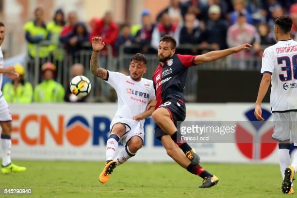 Leonardo Pavoletti of Cagliari in contrast with a player of Crotone during the Serie A match between Cagliari Calcio and FC Crotone at Stadio...