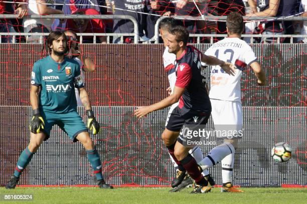 Leonardo Pavoletti of Cagliari scores his team's first goal during the Serie A match between Cagliari Calcio and Genoa CFC at Stadio Sant'Elia on...