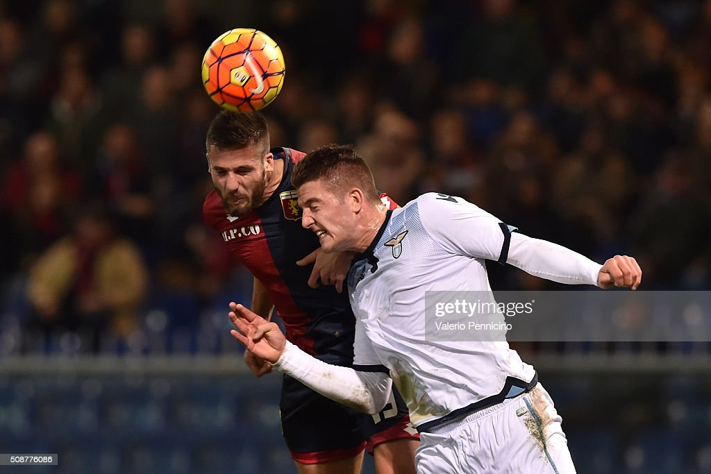 Leonardo Pavoletti (L) of Genoa CFC clashes with Sergej Milinkovic of SS Lazio during the Serie A match between Genoa CFC and SS Lazio at Stadio Luigi Ferraris on February 6, 2016 in Genoa, Italy.