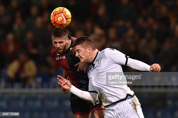Leonardo Pavoletti of Genoa CFC clashes with Sergej Milinkovic of SS Lazio during the Serie A match between Genoa CFC and SS Lazio at Stadio Luigi...