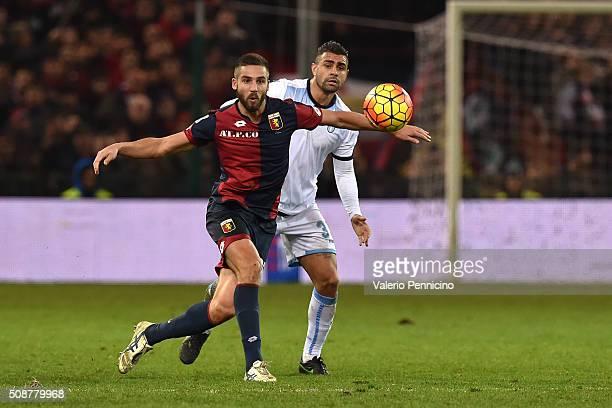Leonardo Pavoletti of Genoa CFC is challenged by Mauricio Dos Santos Nascimento of SS Lazio during the Serie A match between Genoa CFC and SS Lazio...