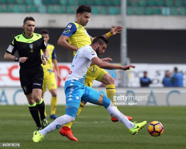 Leonardo Pavoletti of Napoli and Ivan Radovanovic of Chievo compete for the ball during the Serie A match between AC ChievoVerona and SSC Napoli at...