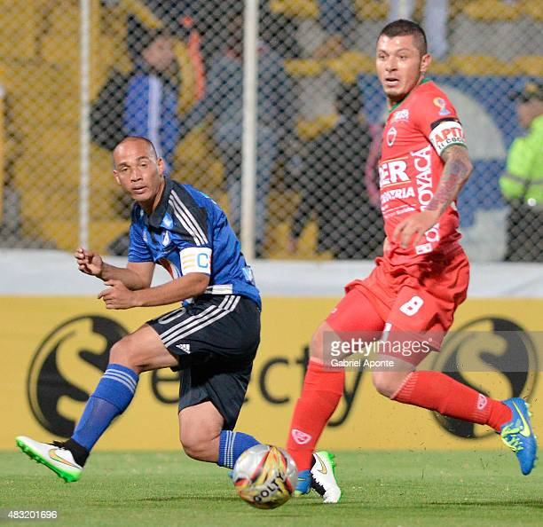 Leonardo Pico of Patriotas FC struggles for the ball with Mayer Candelo of Millonarios during a match between Patriotas FC and Millonarios as part of...