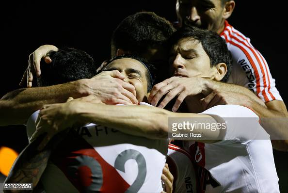 Leonardo Pisculichi of River Plate celebrates with teammates after scoring the opening goal during a match between Olimpo and River Plate as part of...