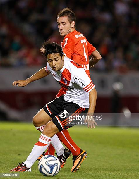 Leonardo Pisculichi of River Plate fights for the ball with Federico Mancuello of Independiente during a match between River Plate and Independiente...