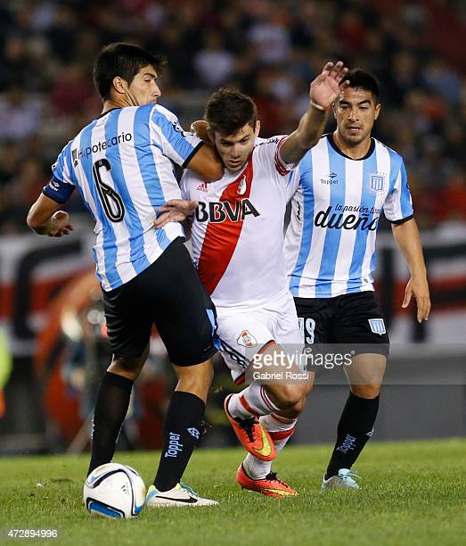 Leonardo Pisculichi of River Plate fights for the ball with Marcos Acuña of Racing Club during a match between River Plate and Racing Club as part of...