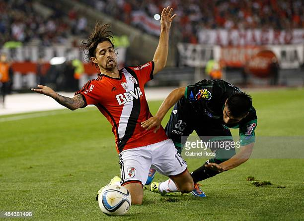 Leonardo Pisculichi of River Plate fights for the ball with Nicolas Pelaitay of San Martin during a match between River Plate and San Martin as part...