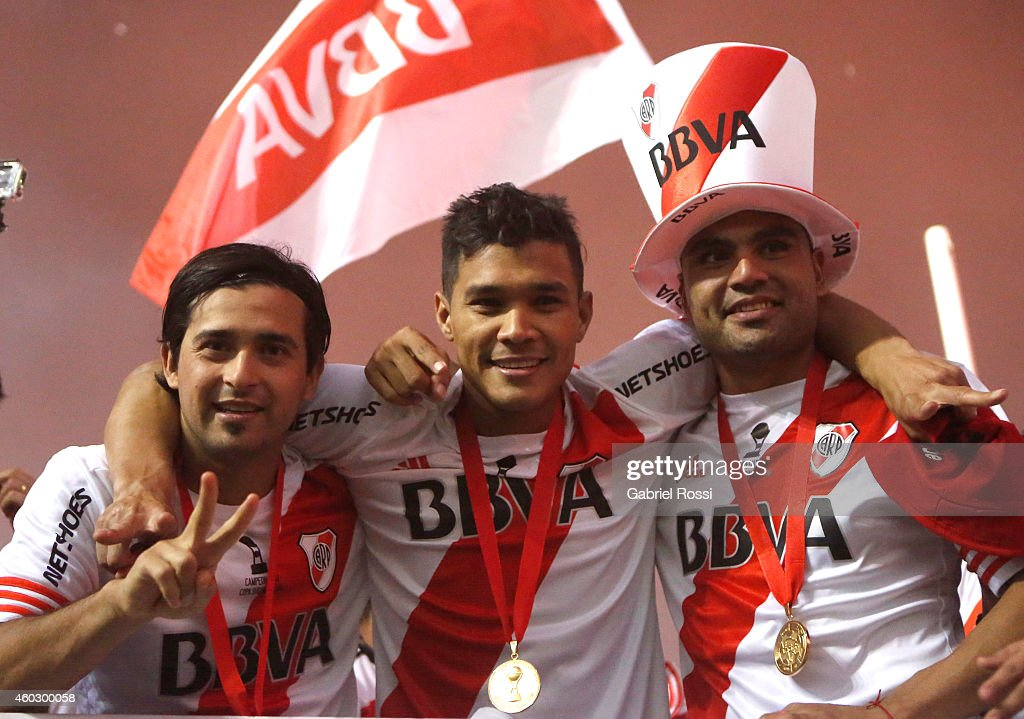 Leonardo Pisculichi, Teofilo Gutierrez and Gabriel Mercado of River Plate celebrate after winning a second leg final match between River Plate and Atletico Nacional as part of Copa Total Sudamericana 2014 at Antonio Vespucio Liberti Stadium on December 10, 2014 in Buenos Aires, Argetina.