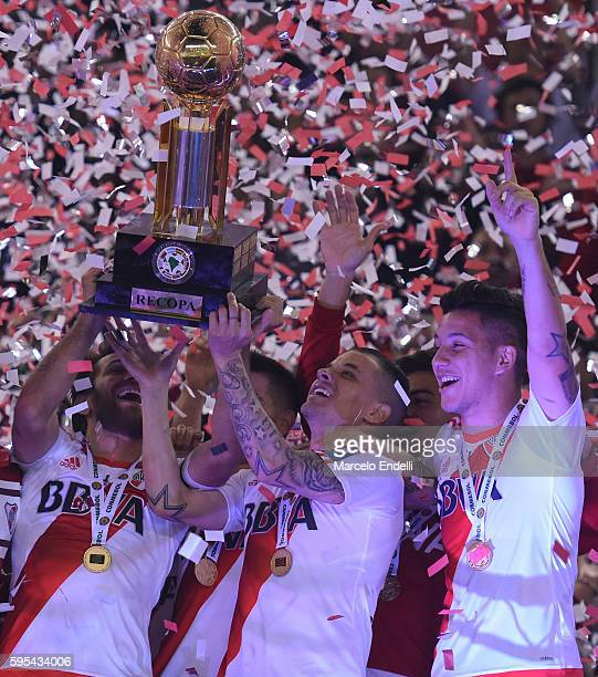 Leonardo Ponzio and Andres D'Alessandro of River Plate lift the trophy after winning the Recopa Sudamericana 2016 during a second leg match between...