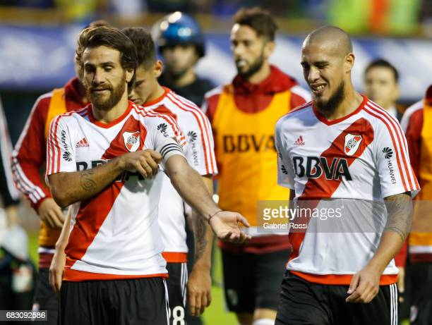 Leonardo Ponzio and Jonathan Maidana leave the field at the end of the first half during a match between Boca Juniors and River Plate as part of...