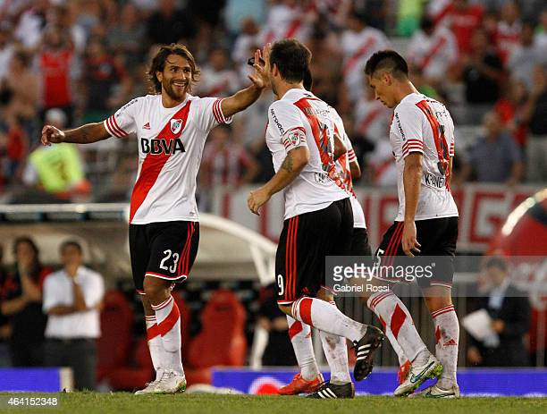 Leonardo Ponzio of River Plate celebrates with his teammates after scoring the second goal of his team during a match between River Plate and Quilmes...